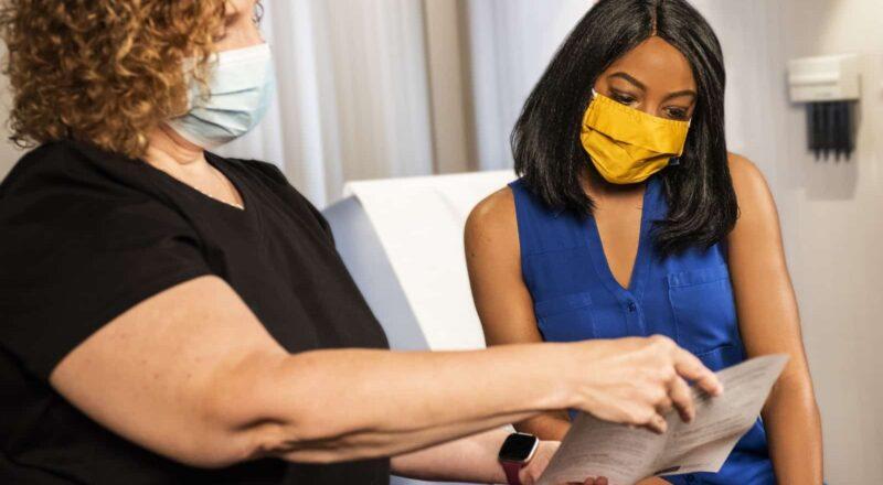 woman in black shirt wearing yellow mask